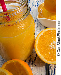 Orange juice in glass on a wooden table