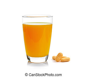 Orange juice in glass with vitamin c tablet on white background