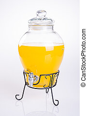 Orange juice in jar on a background.