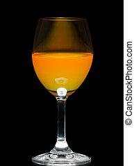 Orange juice in wine glass