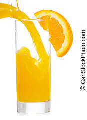 orange juice is pouring into glass