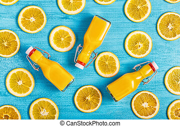 Orange juice on a blue background, top view.
