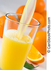 Pouring fresh orange juice in the glass