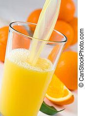 Orange Juice - Pouring fresh orange juice in the glass