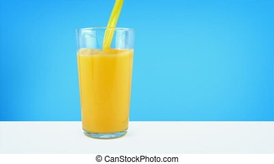 Orange Juice Pouring Into Glass - Orange juice pours into...