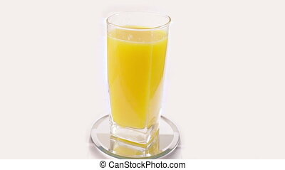 orange juice rotating on white background