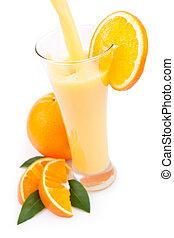 Orange juice splashing in a glass