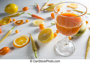 Orange juice with fruits on table