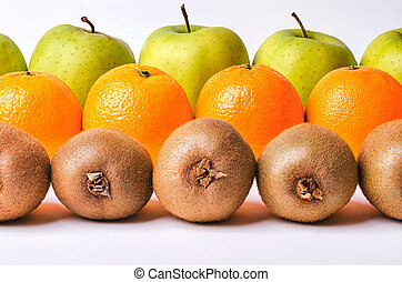 Orange, kiwi and apples in rows