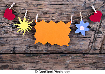 Orange Tag Or Label With Sun And Two Hearts And Flower On A Line With Copy Space Or Your Free Text Here On Wooden Background, Four Symbols, Vintage, Retro And Old Fashion Style