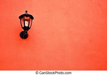 Orange lamp on the wall