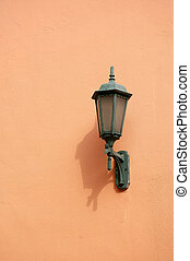 Orange lamp on wall