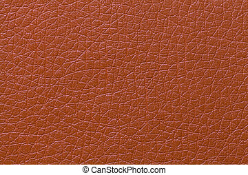 Orange leather texture background with pattern, closeup