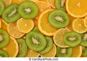 Orange, lemon and kiwi slices background