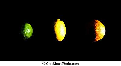 Orange, lemon and lime on black