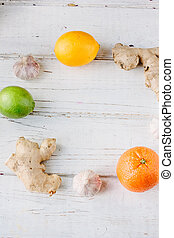 Orange, lemon and lime with ginger roots and garlic
