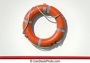 life bouy - orange life bouy with rope on the white side ...