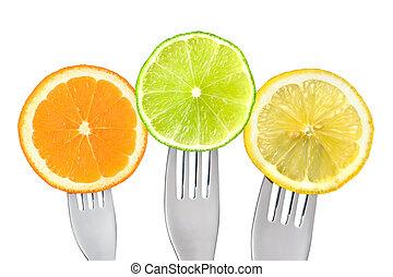 orange lime lemon slices on forks isolated