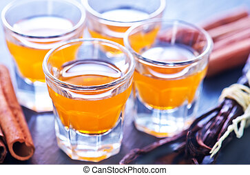 orange liquor in small glasses and on a table