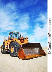 Orange loader bulldozer with cloud sky