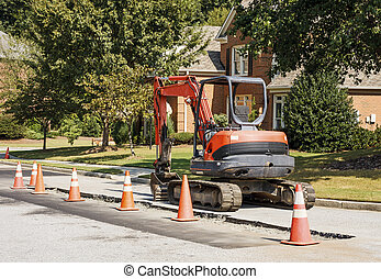 Orange Loader in Residential Construction