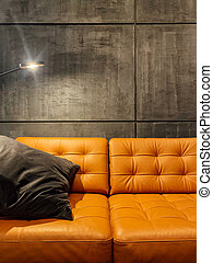 orange loft sofa with a light lamp in the room