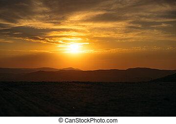 Orange majestic sunset in the mountains landscap.