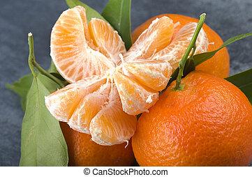 Orange mandarin or tangerine fruit with leaves