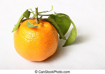 Orange mandarin with green leaves on clear background