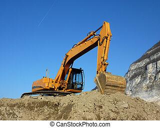 Orange mechanical digger - Big orange excavator standing on...