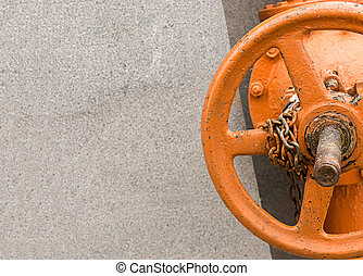 orange metal valve part of the gas equipment closed fixed on a monochrome gray background copy space design advertising web