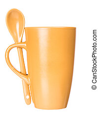 Orange mug with spoon empty blank for coffee or tea isolated on white background
