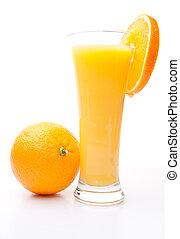 Orange near a glass of orange juice