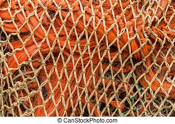 Orange Nets - Orange and white fishing nets.