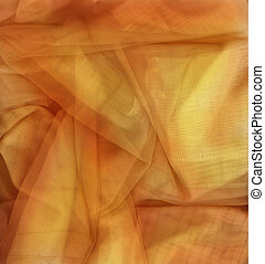Orange and gold netting fabric perfect for a background.