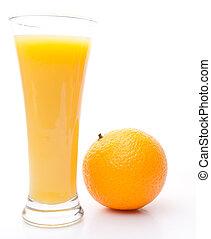 Orange next to a glass of orange juice