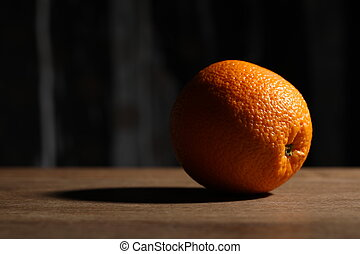 Orange on the wooden table. Close up