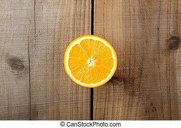 Orange on wooden table