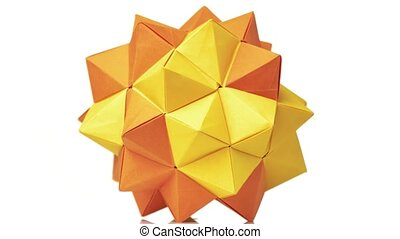 Orange origami transforming spiky ball. Bright isolated...