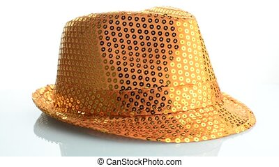 Orange paillette hat - Bright orange paillette hat on white...