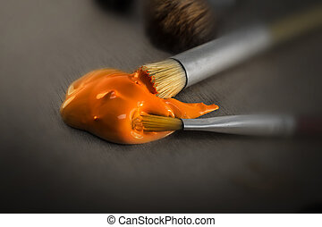 Orange Paint Glob and Two Paint Brushes