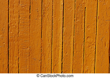 Orange paint on a wooden fence.