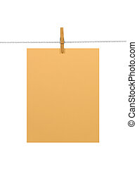 Orange paper sheet on a clothes line (+2 clipping paths) -...