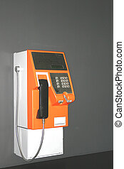 Orange Payphone - Image of an orange public payphone.