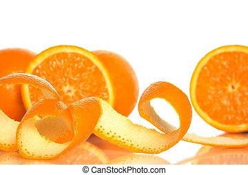 Orange peel and juicy oranges