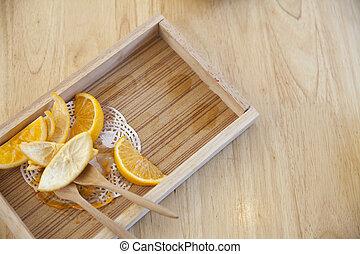 Orange peel on a wooden tray