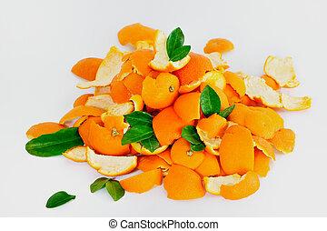Orange Peel - Peel of ripe oranges mixed with green leaves, ...
