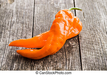 Orange pepper vegetable. - Orange pepper vegetable on old...