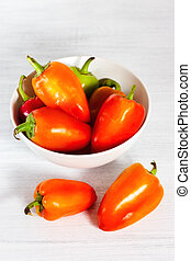 Orange peppers over white background