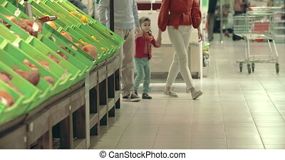 Orange Pick - Family of three approaching camera in...